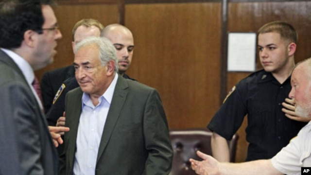 Former IMF chief Dominique Strauss-Kahn stands to depart his bail hearing inside of the New York State Supreme Courthouse in New York . Strauss-Kahn was granted bail by a New York judge, May 19, 2011