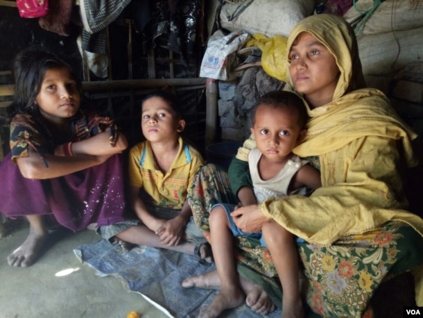Habiba, 32, and her three children at a Rohingya village in Bangladesh. According to the Rohingya woman, she was raped by a Burmese soldiers and a Mogh, after her husband was beaten up and taken away from her village in Rakhine in December.