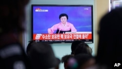 FILE - People watch a TV news program showing North Korea's announcement of a hydrogen bomb test, at the Seoul Railway Station in Seoul, South Korea, Jan. 6, 2016.