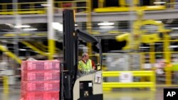 FILE - A forklift operator moves a pallet of goods at an Amazon.com fulfillment center in DuPont, Wash. This year, Amazon has been making an aggressive push to offer same-day delivery to its $99 annual Prime loyalty club members, Feb. 13, 2015.