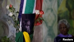 People gather to pay their respects to Winnie Madikizela-Mandela in Durban, South Africa, April 2, 2018.
