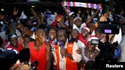 Supporters of Ghanaian presidential candidate Nana Akufo-Addo of the opposition New Patriotic Party (NPP) celebrate after he announced that he won the presidential election during a press conference at his private home in Accra, Ghana Dec. 8, 2016.