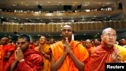 Buddhist monks pray during the inaugural ceremony of the International Conference on World Peace and Buddhism in Mumbai, India. (file photo).