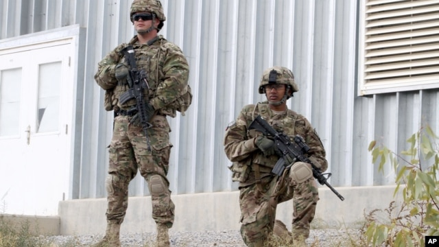US soldiers stand guard in Qalat, Zabul province, Afghanistan, November 28, 2012.