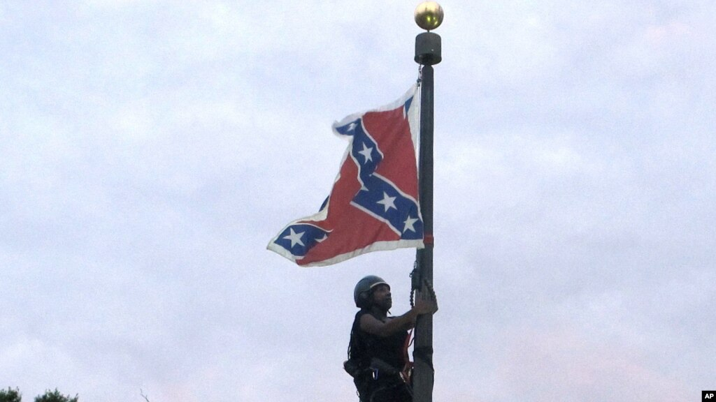Flag At A Confederate Monument In Front Of The State House In Columbia