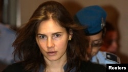 FILE - Amanda Knox, the U.S. student convicted of murdering her British flatmate Meredith Kercher in Italy in Nov. 2007, arrives at the court during her appeal trial session in Perugia, Sept. 30, 2011.