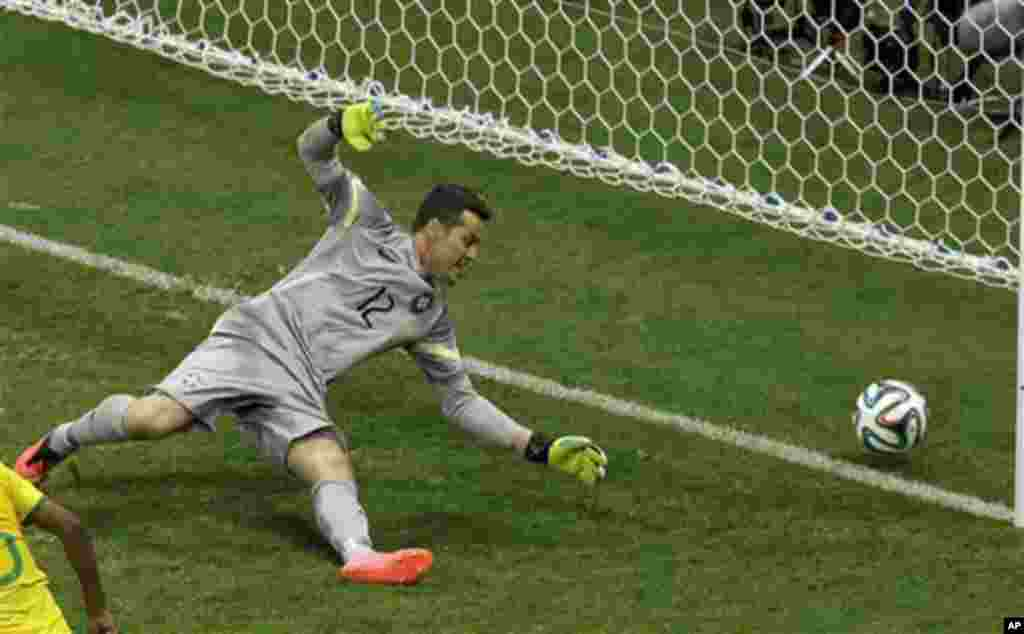 Brazil's goalkeeper Julio Cesar fails to stop Netherland's third goal during the World Cup third-place soccer match between Brazil and the Netherlands at the Estadio Nacional in Brasilia, Brazil, Saturday, July 12, 2014. (AP Photo/Themba Hadebe)
