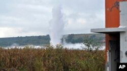 A geyser of gasoline spews from a state-owned pipeline at a field in Tlajomulco, Mexico, Oct. 30, 2013.