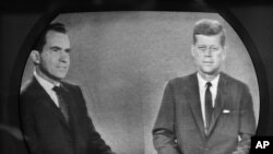 Vice President Richard M. Nixon (l) listens as Senator John F. Kennedy talks during their televised presidential race debate,Oct. 21, 1960.