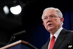 FILE - Then-Attorney General Jeff Sessions speaks during a news conference at the Department of Justice in Washington, Nov. 1, 2018.