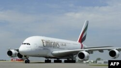 FILE - Emirates Airline's Airbus A380 lands for the first time at Schiphol Airport on August 1, 2012. The A380 is the largest and heaviest passenger plane in the world and can accommodate over 500 passengers.
