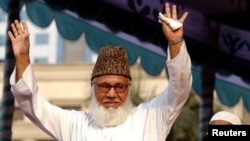 Moulana Motiur Rahman Nizami, chief of the Jamaat-e-Islami, Bangladesh's biggest Islamic Political Party and an alliance of the ruling Bangladesh Nationalist Party, waves to his supporters during a rally protesting against Western newspapers that publishe