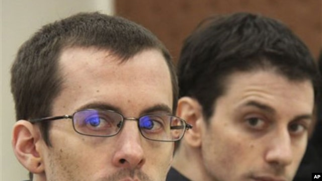 A picture released by Iran's state-run Press TV shows US hikers Shane Bauer (L) and Josh Fattal (R), detained in Iran on spying charges, during the first session of their trial, February 6, 2011.
