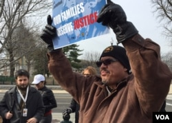 About 50 immigrants protested outside the Supreme Court, urging the justices to take up a case involving President Obama's executive order on immigration. (Carolyn Presutti/VOA)