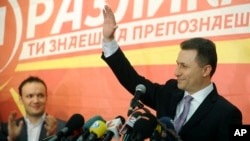 Macedonian Prime Minister and leader of the ruling conservative VMRO-DPMNE Nikola Gruevski greets his supporters while announcing a double victory in parliamentary and presidential elections, in Skopje, Macedonia, Apr. 28, 2014.