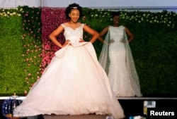 A model presents a wedding gown creation before a TV broadcast of Britain's Prince Harry and Meghan Markle's royal wedding at the Windsor Golf Hotel and Country Club in Nairobi, Kenya, May 19, 2018.