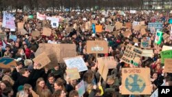 Some thousands of students gather to join a march in support of more ambitious climate policies in The Hague, Netherlands, Thursday Feb. 7, 2019.
