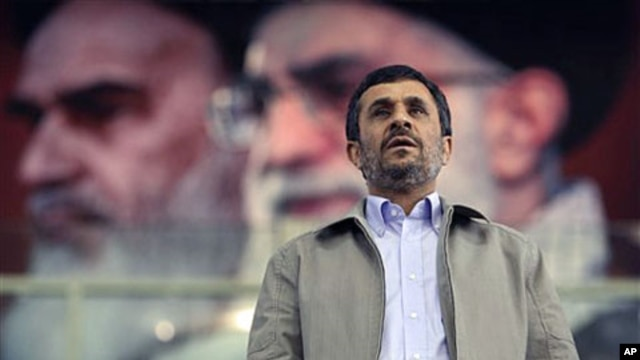 In front of portraits of the late Iranian revolutionary founder Ayatollah Khomeini (L) and supreme leader Ayatollah Ali Khamenei, President Mahmoud Ahmadinejad joins a ceremony commemorating International Day Against Drug Abuse, at the Azadi [Freedom] spo