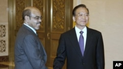 Chinese Premier Wen Jiabao, right, meets Ethiopian Prime Minister Meles Zenawi, at the Great Hall of the People in Beijing, China, August 15, 2011