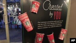 Starbucks holiday cups appear on display Nov. 8, 2016, at a store in New York. Snowflakes, reindeer and candy canes are back on Starbucks holiday coffee cups, after last year's plain red cups caused uproar from critics who said the chain was part of a so-called war on Christmas.