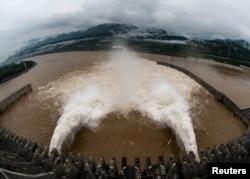 FILE -The Three Gorges Dam on the Yangtze River discharges water to lower the water level in the reservoir following heavy rainfall and floods in a few regions, in Yichang, Hubei province, China July 17, 2020. (China Daily via Reuters)