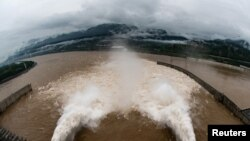 The Three Gorges Dam on the Yangtze River discharges water to lower the water level in the reservoir following heavy rainfall and floods in a few regions, in Yichang, Hubei province, China July 17, 2020. The picture was taken on July 17, 2020. (China Daily via Reuters)