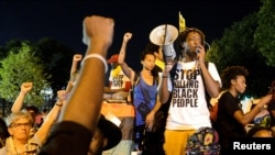 FILE - A Black Lives Matter protester addresses fellow protesters near the site of Democratic National Convention in Philadelphia, Pennsylvania, U.S., July 26, 2016.