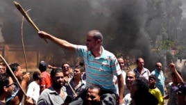 Egyptians chant slogans during clashes between supporters and opponents of Egypt's president and his Muslim Brotherhood in Luxor, June 19, 2013.