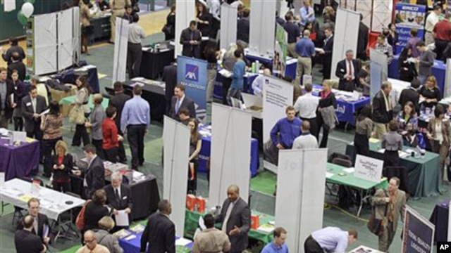 Job seekers pack the aisles of the 32nd Annual Spring Career Fair at Cleveland State University on a day when the jobless report showed employers hired in February at the fastest pace in almost a year, and the unemployment rate fell to 8.9 percent, March
