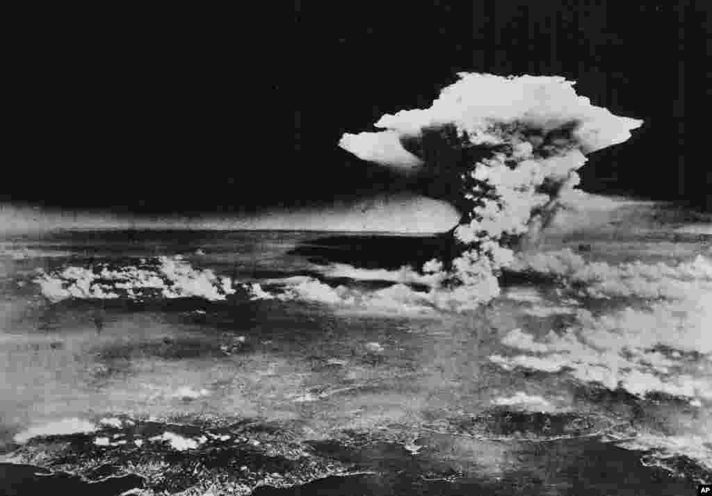 In this Aug. 6, 1945 photo released by the U.S. Army, a mushroom cloud billows about one hour after a nuclear bomb was detonated above Hiroshima.