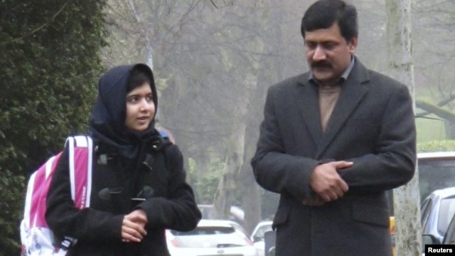 Malala Yousufzai walks with her father Ziauddin as she attends Edgbaston High School for girls in Edgbaston, England March 19, 2013