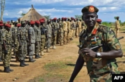 FILE - Members of the Sudan People's Liberation Army line up outside Juba, South Sudan, April 14, 2016.