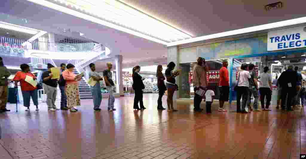 Voters wait in line at a polling place located inside a shopping mall in Austin, Texas.