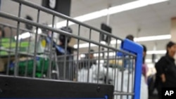 Shoppers wait in line to pay for their purchases at a Walmart (File)