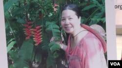 Ảnh bà Sandy Phan-Gillis trong một bích chương vận động đòi trả tự do cho bà. (G. Flakus/VOA)