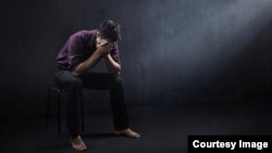 FILE - A depressed man is seen in a photo illustration.