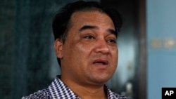 FILE - Outspoken Uighur scholar and advocate Ilham Tohti speaks during an interview at his home in Beijing.