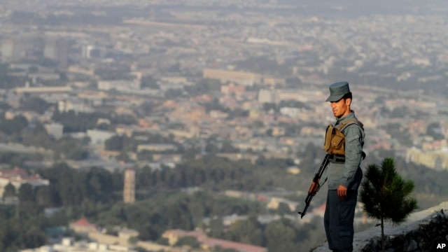 An Afghan police officer on guard in Kabul, Afghanistan.