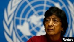FILE - U.N. High Commissioner for Human Rights Navi Pillay attends a news conference at the United Nations European headquarters in Geneva, Switzerland, Dec. 2, 2013.