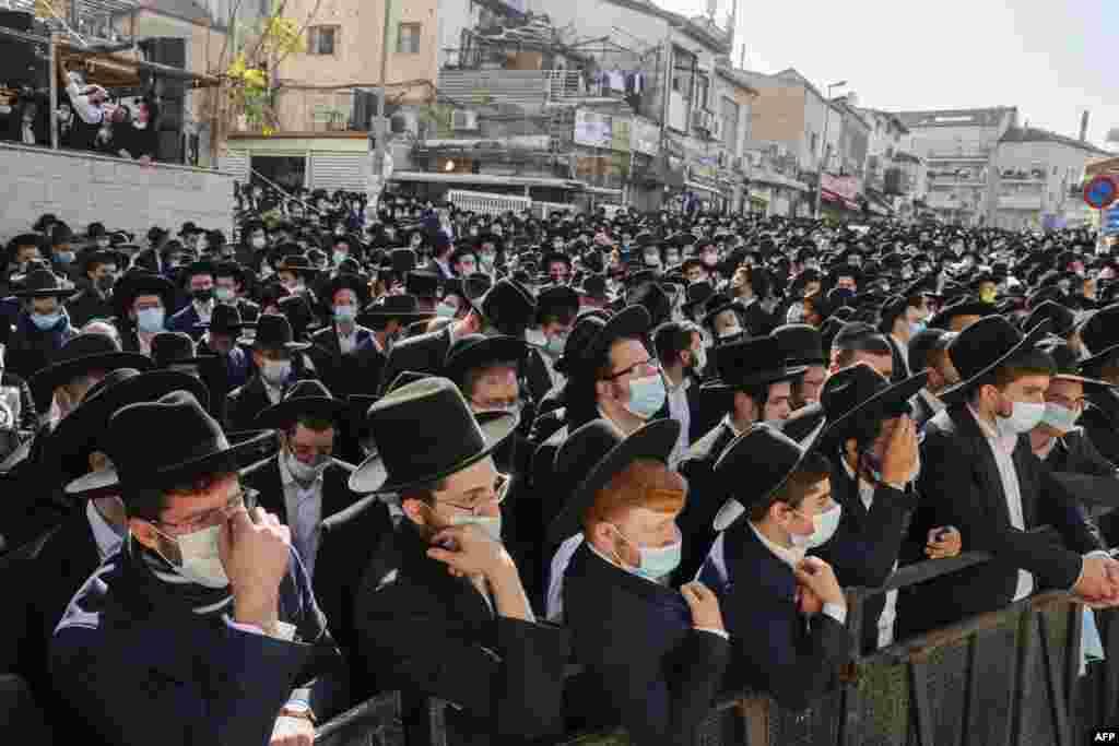 Despite the coronavirus pandemic, thousands of Ultra-orthodox Jewish men attend the funeral of Rabbi Aharon David Hadash, the spiritual leader of the Mir Yeshiva, in Jerusalem's Ultra-Orthodox neighbourhood of Beit Yisrael.
