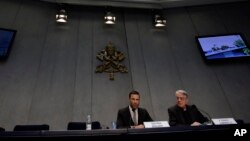 FILE - Rene Brulhart (L), director of the Financial Information Authority, an institution established to monitor the monetary and commercial activities of Vatican agencies, and Vatican spokesman Federico Lombardi, are seen at the Vatican, May 22, 2013.
