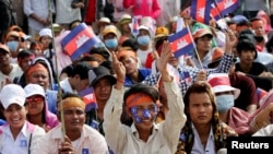 Supporters of the opposition Cambodia National Rescue Party (CNRP) with the national flags gather during a protest at the Freedom Park in central Phnom Penh, Oct. 23, 2013.