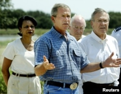 In this August 8, 2003 file photo, US President George W. Bush is flanked by (L-R) National Security Advisor Condoleezza Rice, Vice President Dick Cheney, and Secretary of Defense Donald Rumsfeld.