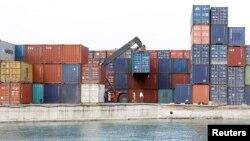 A crane arranges containers at the Port of Zanzibar on the island of Zanzibar, July 19, 2012.