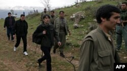 A picture taken on March 13, 2013 shows Turkish prisoners as they were released in the northern Iraqi city of Dohuk, after being held for two years in northern Iraq by the Kurdish Workers' Party (PKK).