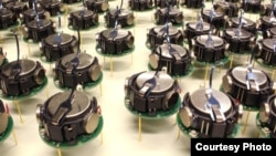 Several kilobots from a swarm of 1,000 simple, but collaborative, robots are seen in this photo from Harvard.