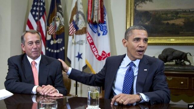 Predsednik Predstavničkog doma Džon Bejner i predsednik Barak Obama (arhivski snimak)