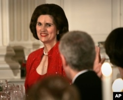 FILE - Linda Robb is recognized by then-President George W. Bush during a toast at a dinner celebrating the 40th anniversary of the National Endowment for the Arts and the National Endowment for the Humanities in the State Dinning Room of the White House, Nov. 10, 2005, in Washington. Linda Robb's father, Lyndon B. Johnson, started the endowments under his presidency.
