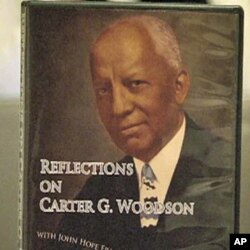 FILE - A poster of Dr. Carter G. Woodson, a founder of the Association for the Study of African American History