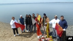 The cleanup volunteers accumulate a pile of prayer flags, saris and other trash left over from sacred Hindu ceremonies.